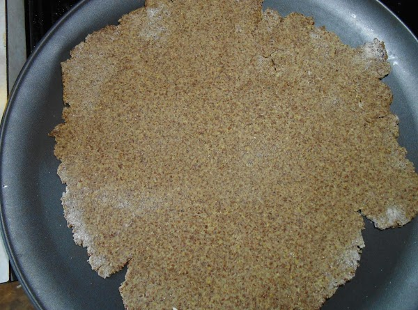 Sprinkle a tiny bit of wheat flour on counter top and roll half the...