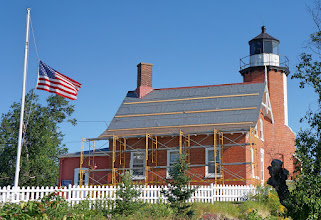 Photo: Eagle Harbor Light is a working lighthouse at Eagle Harbor, Keweenaw County, MI. It sits on the rocky entrance to Eagle Harbor and is one of several light stations that guide mariners on Lake Superior across the northern edge of the Keweenaw Peninsula. The original lighthouse, built in 1851, was replaced in 1871 by the present red brick structure