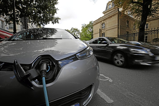 Technological change: An electric car being charged on a Paris street. The consumption of lithium, which is used in batteries, will increase threefold in a decade, brokerage SP Angel forecasts. Picture: REUTERS