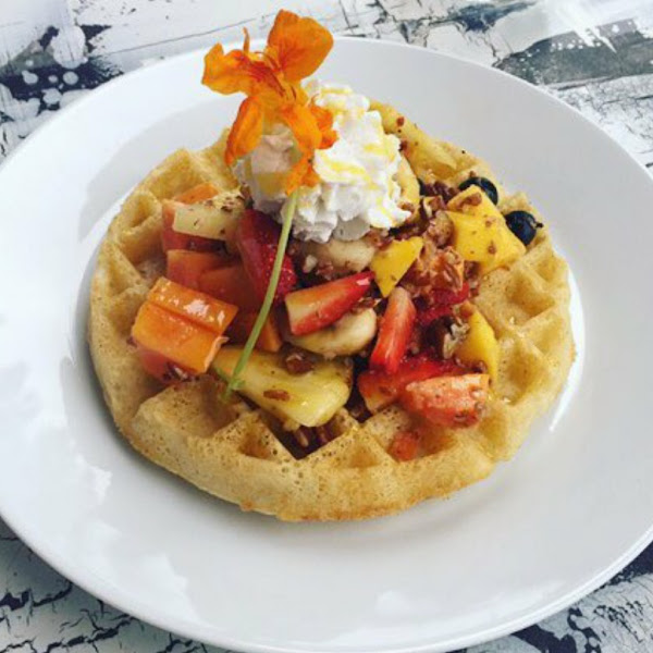 Gluten Free Waffle with cashew whip and fresh fruit at Lilikoi Organic Living