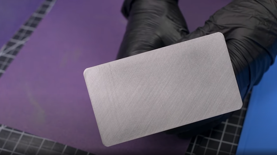 A couple quick swipes on the 80 grit sandpaper will introduce some gouges to give 3D prints more bite.