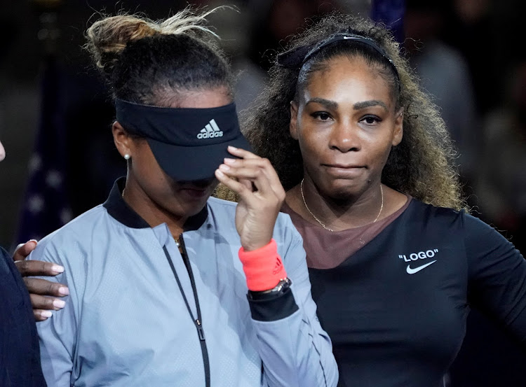 Naomi Osaka of Japan (L) cries as Serena Williams (R) of the USA comforts her after the crowd booed during the trophy ceremony following the women's final on day thirteen of the 2018 US Open tennis tournament at USTA Billie Jean King National Tennis Center in New York on September 8, 2018.