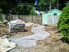 Photo: Acorn Ponds & Waterfalls, Certified Aquascape Contractor of Rochester NY since 2004. Check out our website www.acornponds.com and give us a call 585.442.6373.  Landscaping Penfield NY, work has begun. Patio and #Walkway were marked out, dug out and we are on our way to adding a little more paradise to this Penfield NY home.  To learn more and #LandscapeIdeas please click here: www.acornponds.com/landscape-design.html  For More info about Geoff and Karen's amazing project please visit www.facebook.com/notes/acorn-landscaping-landscape-designlightingbackyard-water-gardens/landscape-design-installation-walkway-patio-rock-fountain-waterfall-in-penfield-/238744206162709  Acorn Ponds & Waterfalls of Rochester NY, 585-442-6373, is a Certified Aquascape Contractor, Landscape Designer, Outdoor Lighting Designer, Installer, Builder, Contractor and Design Service Company from Rochester, NY. We have professional Installation and Design Services available for the following: Landscape Design Outdoor Room Design Backyard Ponds and Waterfalls Design & Construction Patios and Walkways: Paver, Stone, Brick Low Voltage Landscape Lighting LED Landscape Lighting Swimming Ponds Ecosystem Ponds LED Outdoor Lighting Retaining Walls Fountains Water Features Pondless Waterfalls Pond Maintenance and Design Aquatic and Under Water LED Lights Bubbling Boulders and Urns Natural Stone Patios and Rock Gardens Garden Ponds Outdoor Kitchens Pizza Ovens Fire Pits Fish or Koi Ponds Waterfall Ponds Low Maintenance Plantings Commercial Landscape Design Residencial Landscape Design Drainage Issues, Solutions Aquascape Rainwater Collection Systems  We serve Pittsford NY, Penfield NY, Brighton NY, Fairport NY, Webster NY, Greece NY, Victor NY, Henrietta NY, Irondequoit NY, Rush NY  Sign up for your personal design consultation here: www.acornponds.com/contact-us.html  Click here for a free Magazine all about Ponds and Water Features: http://flip.it/gsrNN  Acorn Ponds & Waterfalls  585.442.6373 www.a