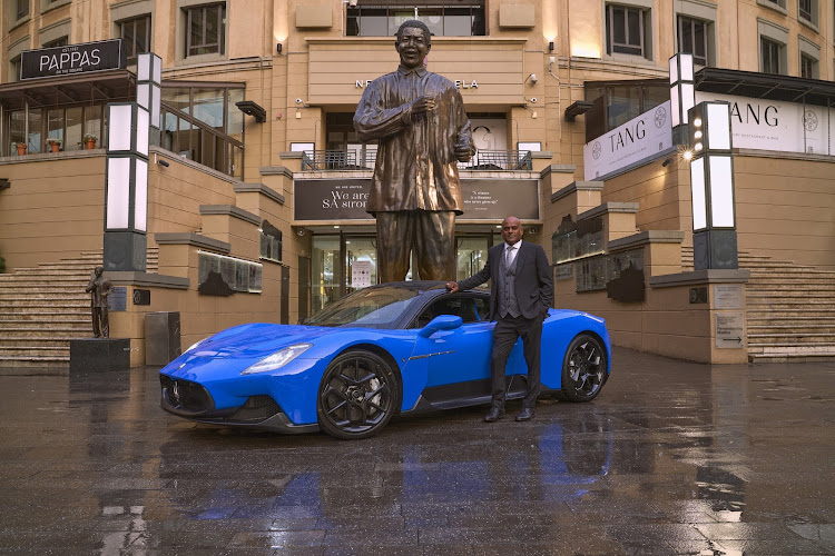 Maserati Johannesburg's Dealer Principal, Nagesh Naidoo, with the MC20 in Sandton's Nelson Mandela Square. Picture: SUPPLIED