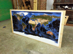 Photo: Large world map mounted on a sheet of plywood for a client