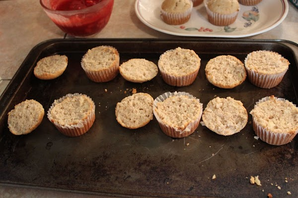 Slicing the tops off cupcakes.