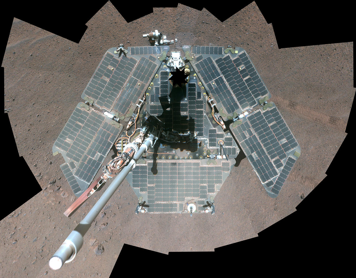 A self-portrait from overhead shows a view of the rover solar panels, which appear grayish-green and wiped clean of dust.