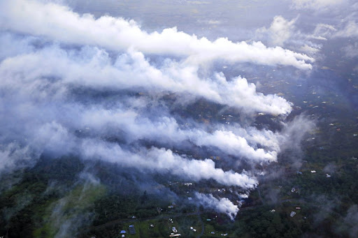 Smoke and steam rise from fissures in the Leilani Estates subdivision during eruptions of the Kilauea Volcano in Hawaii, on May 13 2018. Picture: REUTERS