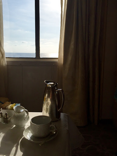 Morning coffee, captured in the softly filtered light of daybreak.