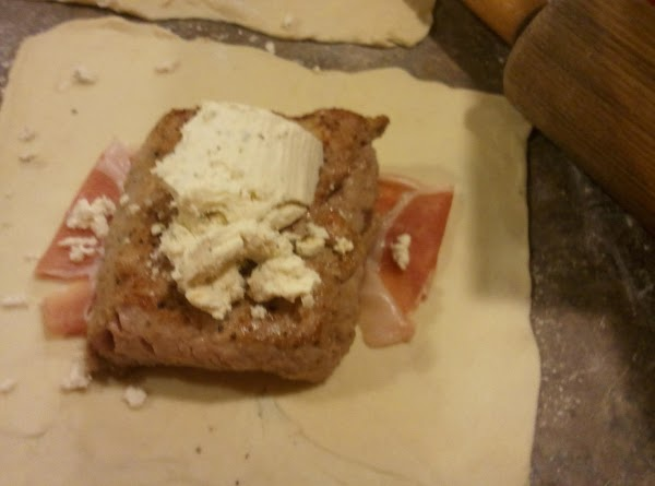 Place one slice of proscuitto in center of each square, then top with cooled...