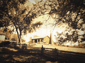 Photo: Old-fashioned sepia photo of a fence, barn, and windmill at Cox Arboretum in Dayton, Ohio.