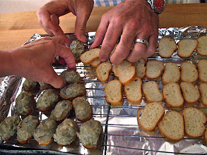 Photo: baguette slices being mounded with shrimp mixture