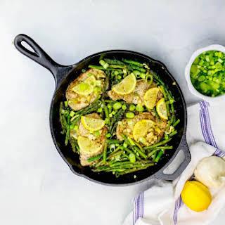 One Pot Lemon Garlic Pork Chops and Asparagus Skillet.