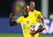 Zimbabwe's captain and striker Knowledge Musona celebrates after Khama Billiat scored the equalising goal during the Afcon 1-1 draw against Uganda in Cairo on Wednesday June 26 2019.