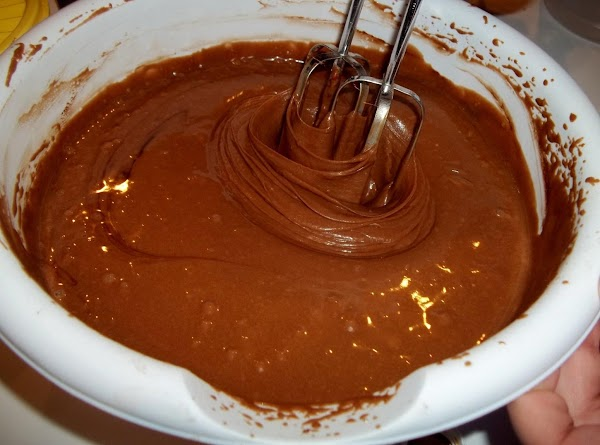 In a bowl, combine the first five ingredients. Add the water, oil, vinegar and...