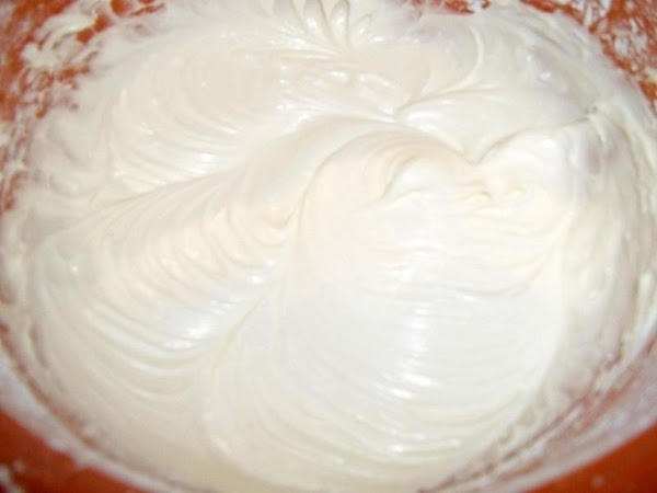 Make frosting:  In a medium bowl, mix the cream cheese with the butter until thoroughly...