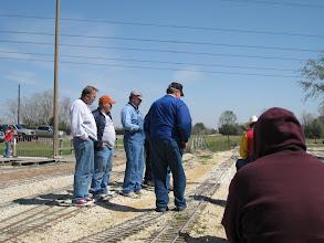 Photo: Train Crews talking and walking on the tracks.   HALS 2009-0228