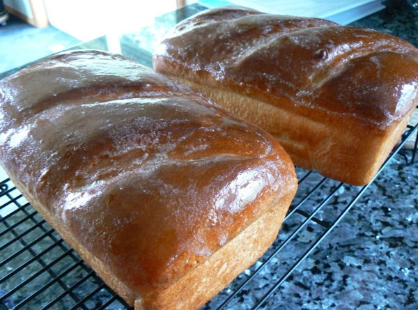 Brush tops with water and make diagonal slashes across the tops Bake at 375 degrees...
