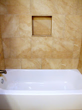 Photo: Centered recessed soap dish with a new tub