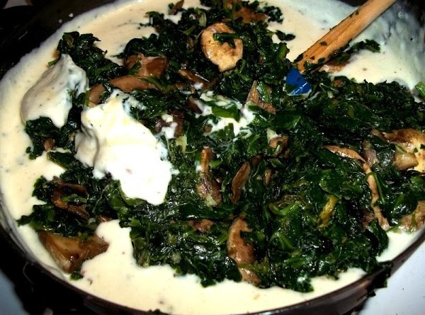 With clean hands...lightly pushed down on the spinach - mushroom mixture, carefully pressing out...
