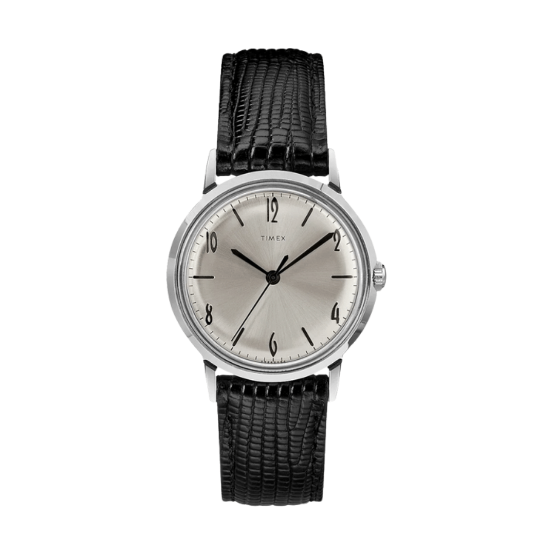 Timex dress watch featuring a leather strap, a silver dial and a silver case.