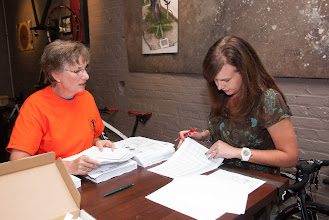 Photo: Deana Sun and Cristina Bizzarri get organized for the Friday night registration at Carytown Bicycles
