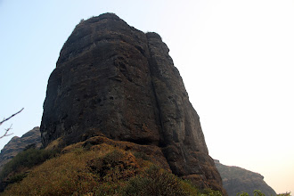 Photo: The route can clearly be seen, up the main crack to the P1 ledge, then to the sloping P2 ledge, another ledge to the right where there is a bolt, and then to the top where there is a slab to a very large cactus. Then, the route takes a short pitch to the right and then another shorter pitch left to the summit. Richie Kher and Sunny Jamshedji are on the P2 slopey belay, while Ajit Bobhate has disappeared under the cactus above the last wide crack.  (Courtesy Ketan Vaidya)