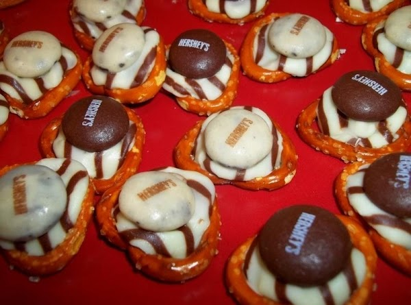Top each with a holiday M&M or decorative candy of choice.   Allow to cool...
