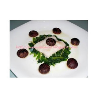 Healthy Steamed Fish With Leafy Spinach.