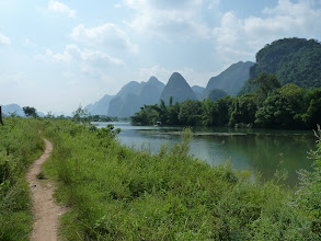 Photo: Yangshuo - biking around on ebike, path which is NOT for bikes, irrigation canals and safe bridge as everything in rice fields, water everywhere around roads