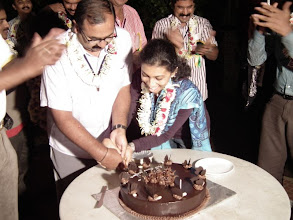 Photo: Wife Gayatri helps Arul with the cake cutting