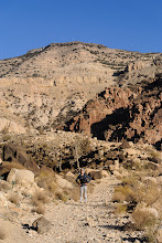Photo: Waiting for Serene to catch up. Our destination, Dana Village, can be seen on the rim of the canyon above.
