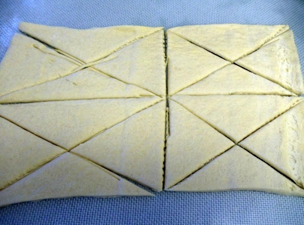 Meanwhile, unroll dough into 4 rectangles. Cut each rectangle into quarters by making another...