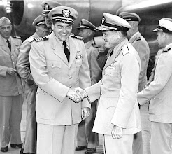 Photo: Capt. G. H. Duffy greets VADM R. Goldthwaite, Chief of Naval Air Training, Pensacola, FL as he arrives for an informal tour of Chase Field.