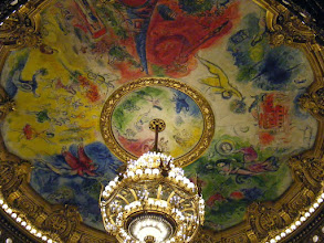 Photo: The ceiling area surrounding the chandelier contains a 1964 painting by Marc Chagall depicting scenes from operas by 14 composers.