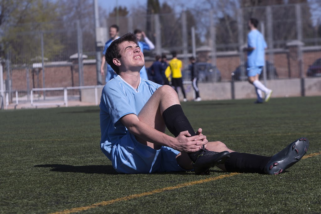Soccer player with ankle injury