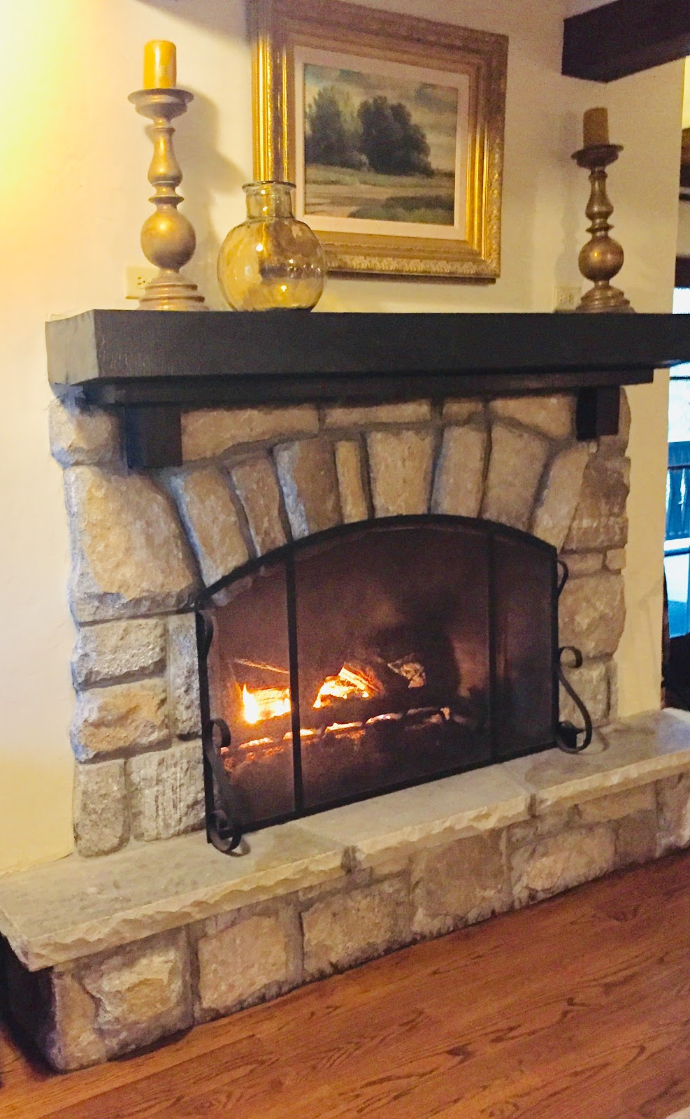 Stone Fireplace With Black mantel