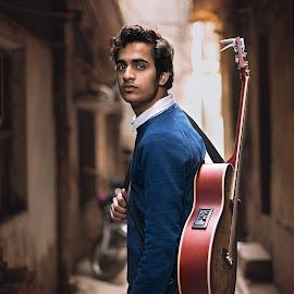 The Guitarist by Tayyeb Mubarik - People Portraits of Men ( musicianphotography, portraitphotography, portrait, oldcity, musician, guitarist, guitar )