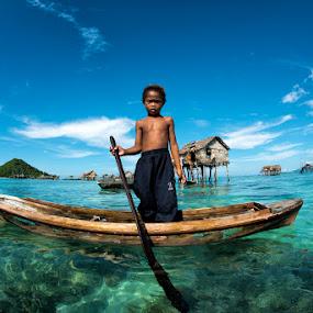 The Little Boatman by Siew Jun Han - People Street & Candids ( clear, water, child, blue, children, sea, boat, gypsy )
