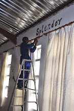 Photo: Precious Samuel helping me to hang the freshly washed curtains in the tabernacle. What a worker!