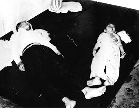 Photo: A father with his son were killed by Communist while sleeping  http://www.vietnam.ttu.edu/virtualarchive/items.php?item=VA056306  Một người cha với con trai mình đã bị Việt cộng giết trong khi ngủ