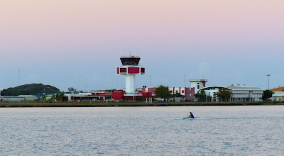 Photo: Just paddling past the airport!  We had to radio in to cross each end of the airstrip.