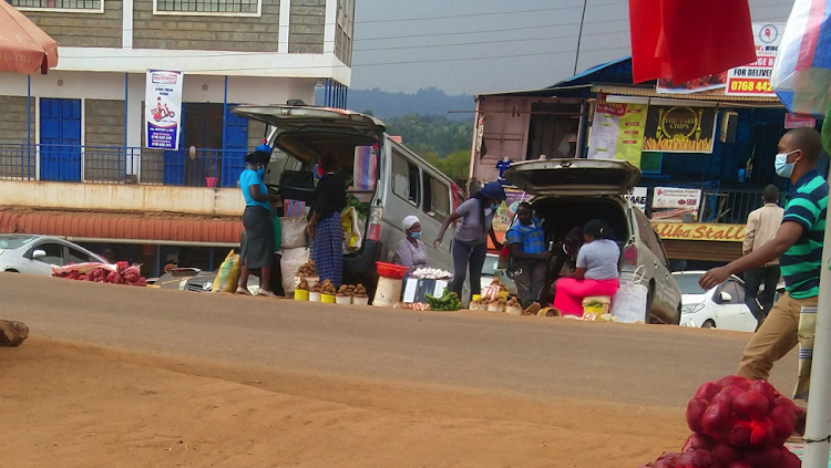Traders outside Wangige Market selling food out of car boots