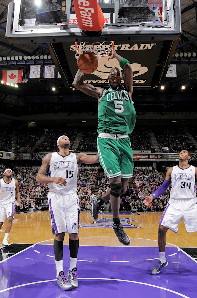 Photo: SACRAMENTO, CA - DECEMBER 30: Kevin Garnett #5 of the Boston Celtics dunks against DeMarcus Cousins #15 of the Sacramento Kings on December 30, 2012 at Sleep Train Arena in Sacramento, California. NOTE TO USER: User expressly acknowledges and agrees that, by downloading and or using this photograph, User is consenting to the terms and conditions of the Getty Images Agreement. Mandatory Copyright Notice: Copyright 2012 NBAE (Photo by Rocky Widner/NBAE via Getty Images)