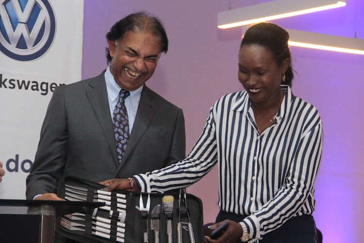Outgoing DT Dobie chairman Zarak Khan receives a gift from Caroline for good service as a chairman