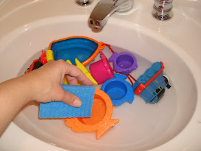 Photo: Scrubbing the bath toys after a 30 minute soak in the Heinz Cleaning Vinegar!