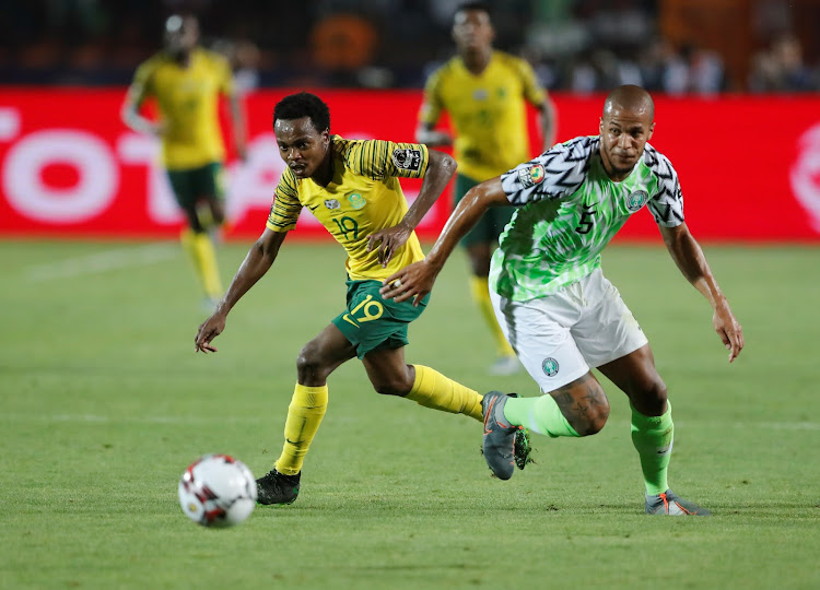 South Africa's Percy Tau in action with Nigeria's William Troost-Ekong during the Afcon quarterfinal match at Cairo's International Stadium on July 10 2019.