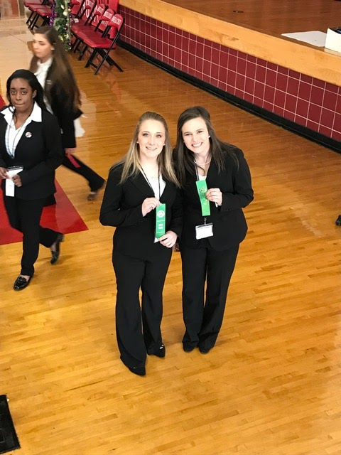 FCAHS HOSA students hold up their awards