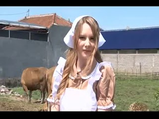 Nadia the cute milkmaid strips and teases