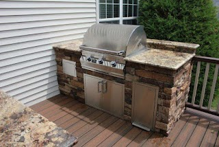 Outdoor Kitchen Deck Choosing Between an and an Patio